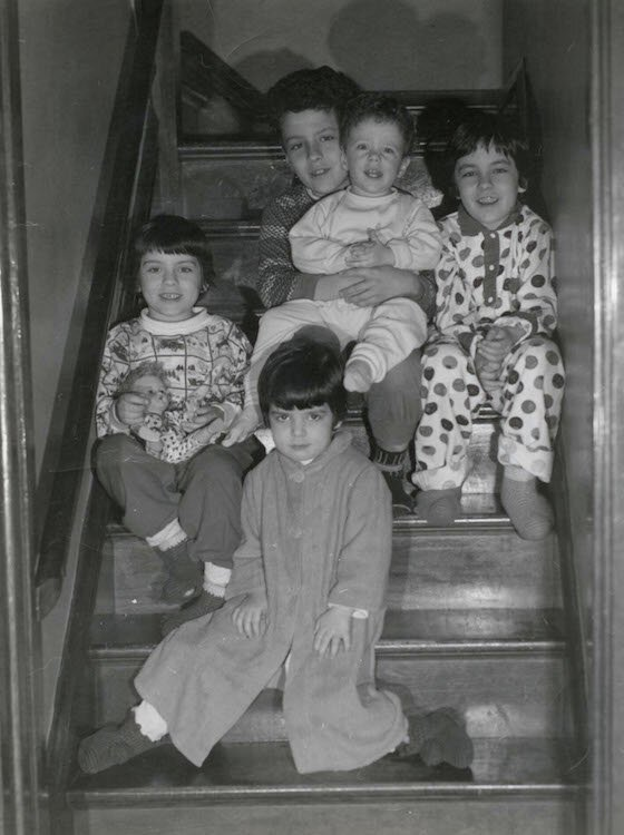 Christmas on the stairs with the five Ferraro children.