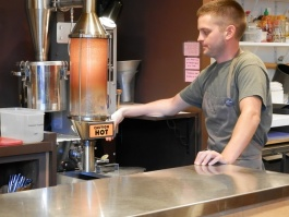Barista Justin Comer demonstrates how they roast the beans right in the shop.