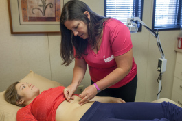 Erica Brooks, 26, of Port Huron receives acupuncture treatment for allergies and digestion.
