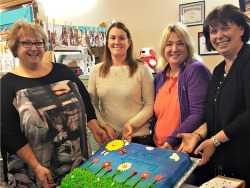 Lynn Vinson, owner of Touchstone Services and A Little Something, Stacey Redfield, director of Touchstone Services, Sallie Smith, employment coordinator for Touchstone Services, and Lucie DeLine, manager of A Little Something celebrate the store's fi