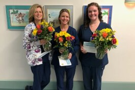 Amy Bolt, Heather Gieleghem and Brittany Kerluke receive a Guardian Angel Award.