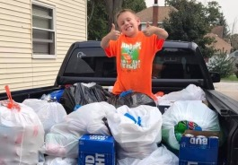 Ryan enjoys helping mom Stacy collect bottles for a hurricane fundraiser.