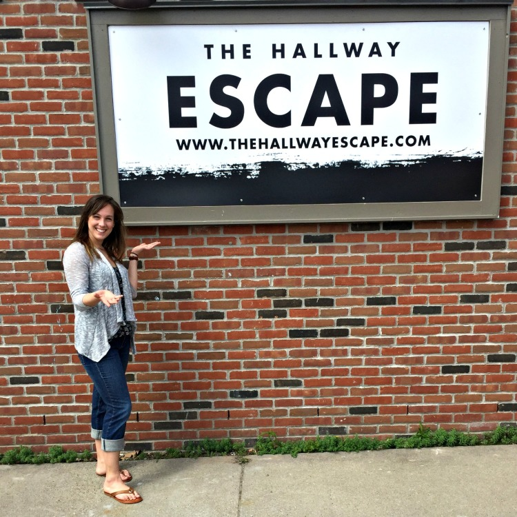 Carol Hall stands outside her new business, The Hallway Escape, in downtown Port Huron.