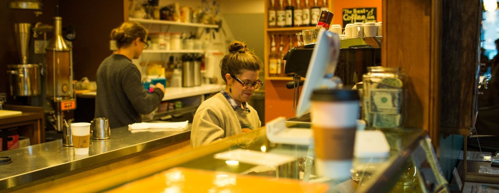 Maggie Bottenfield works on an order at Exquisite Corpse Coffee. <span class='image-credits'>Heather Turner</span>