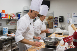 Culinary Insitute instructors Scott Twichell and Karlee Schulz demonstrate how to create a dish.