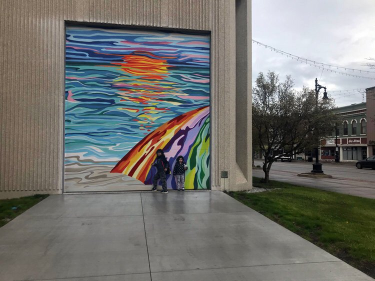 Laura DeNault's winning piece, Photoshopped on the side of the Michigan Mutual building