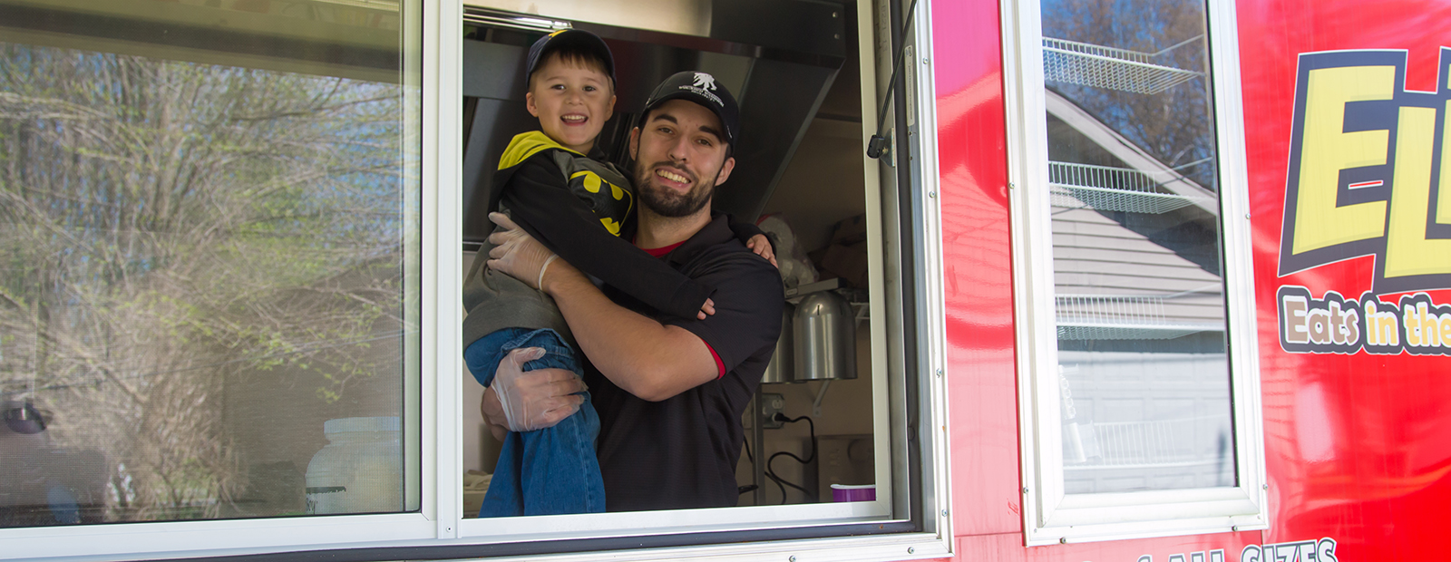 Gary Lokers and son, Eli, ready to roll in the food truck.