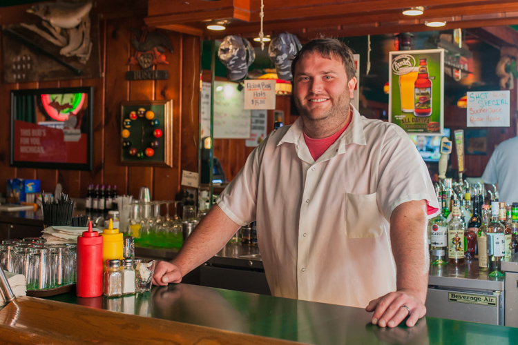 Kurt Slota is ready to serve up great burgers at his bar in Casco.