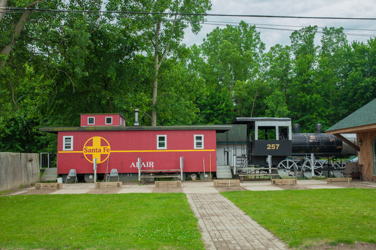 Train cars add ambiance and a place for patrons to hang out at the Adair Bar.