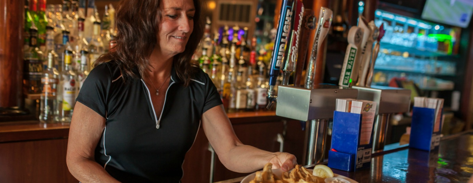 Serving up a plate of fan favorite fish at Riverside Pub