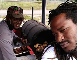 Chef Adrien Lee (left) and Mark Pack get a head start on making food for the Jamaican Jerk food truck.