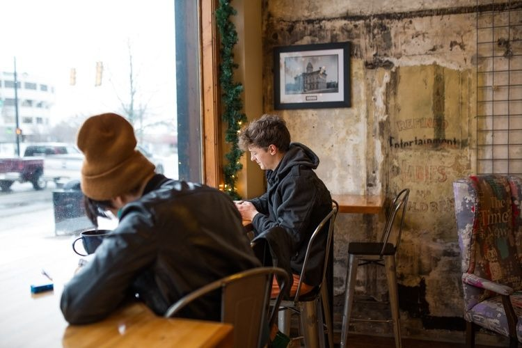 Patrons enjoy coffee at The Exquisite Corpse Coffee House