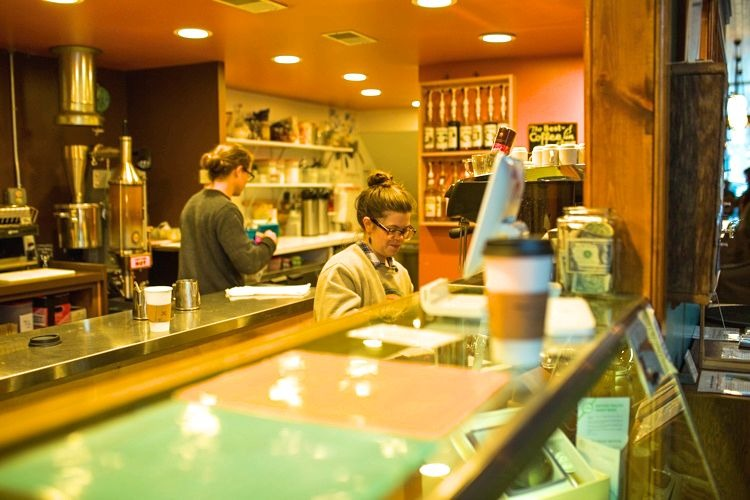 Maggie Bottenfield works behind the counter at Exquisite Corpse Coffee House
