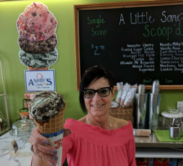 Kim Johnson serves up ice cream with a smile at A Little Something.