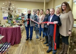 Jackie Morren, second from left, marks the grand opening of The Apothecary with the Marine City Chamber of Commerce.