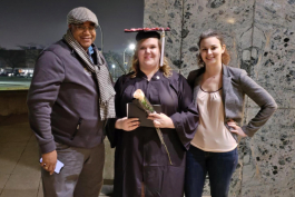 Nikki Leonard (center) with Kevin Totty (left) and Audrey Sochor (right) following graduation.