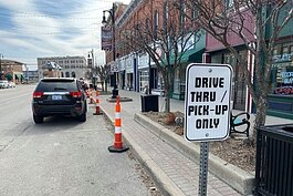 Drive -thru and pick-up lanes have been established in downtown Port Huron to help patrons do their business quickly.