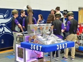 Port Huron Robotics talk with members of the Yale Jiggawattz before a competition.