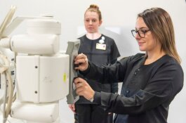 Students learn how to use a portable X-ray machine
