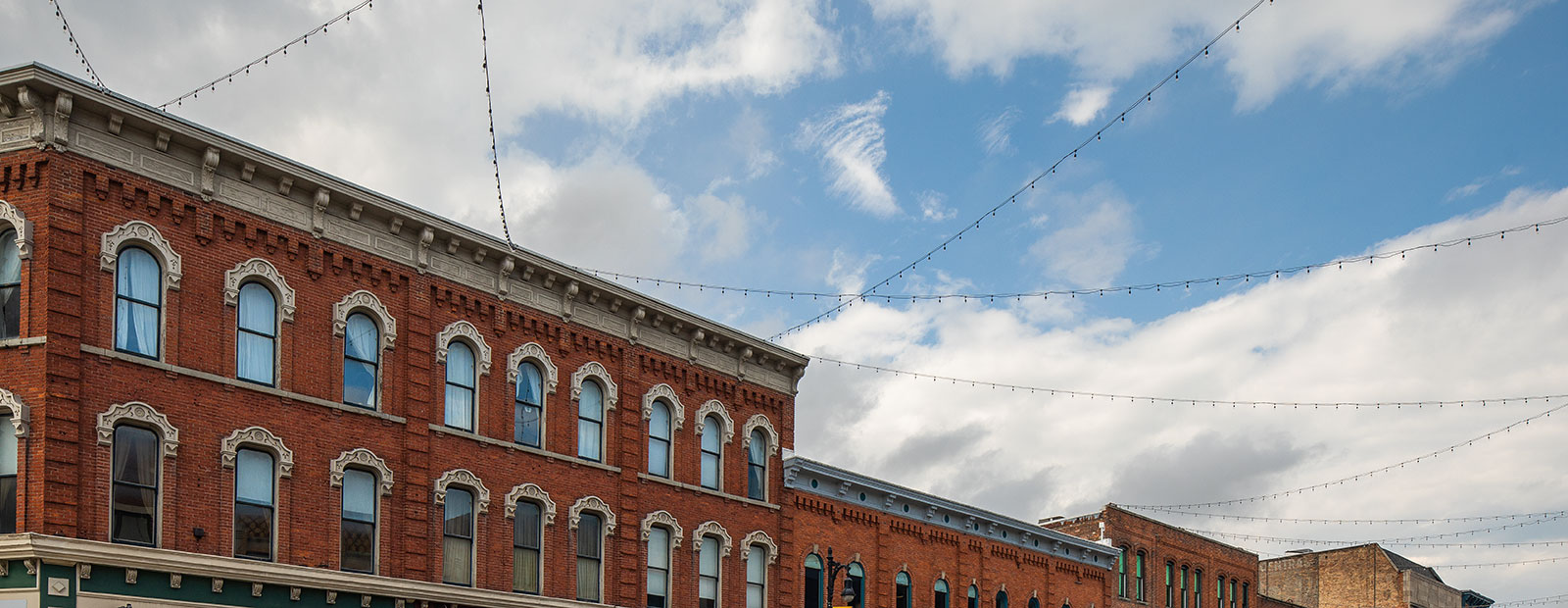 Lights are strung across the buildings of downtown Port Huron. <span class=&apos;image-credits&apos;>David Lewinski</span>