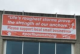 Lisa Bowman and her team designed a sign to be displayed throughout the city, complete with a #PortHuronStrong hashtag and an inspirational quote.