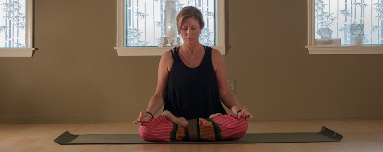 Rhonda Jones shares her love of yoga with the community <span class='image-credits'>Heather Burt</span>