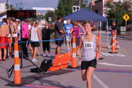 The woman smiling is Jennifer Knightstep, keeping pace in the 2012 Maritime Days 5K Marathon.