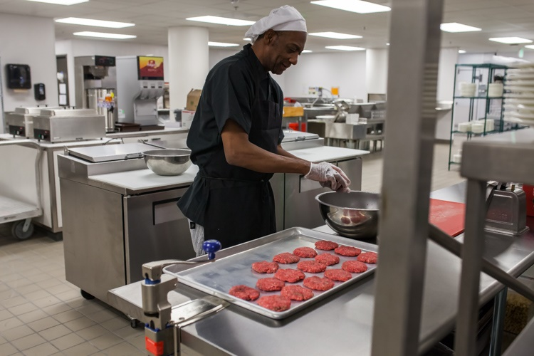 A chef prepares burgers ahead of Friday's grand opening