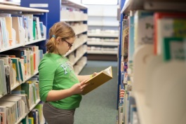 Natalie Turner age 9, of Port Huron. Looking for books to read for the March of Dimes Read-a-thon.