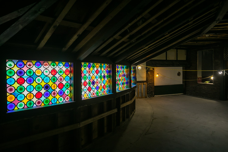 Beautiful stained class adorns the walls of the St. Clair Inn