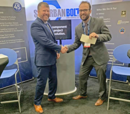 Eric Peterson congratulates a winner during MDEX 2019.