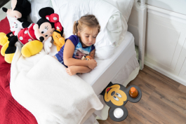 The Disney Smart Shelf tucks into mattresses to keep items like books and water handy.