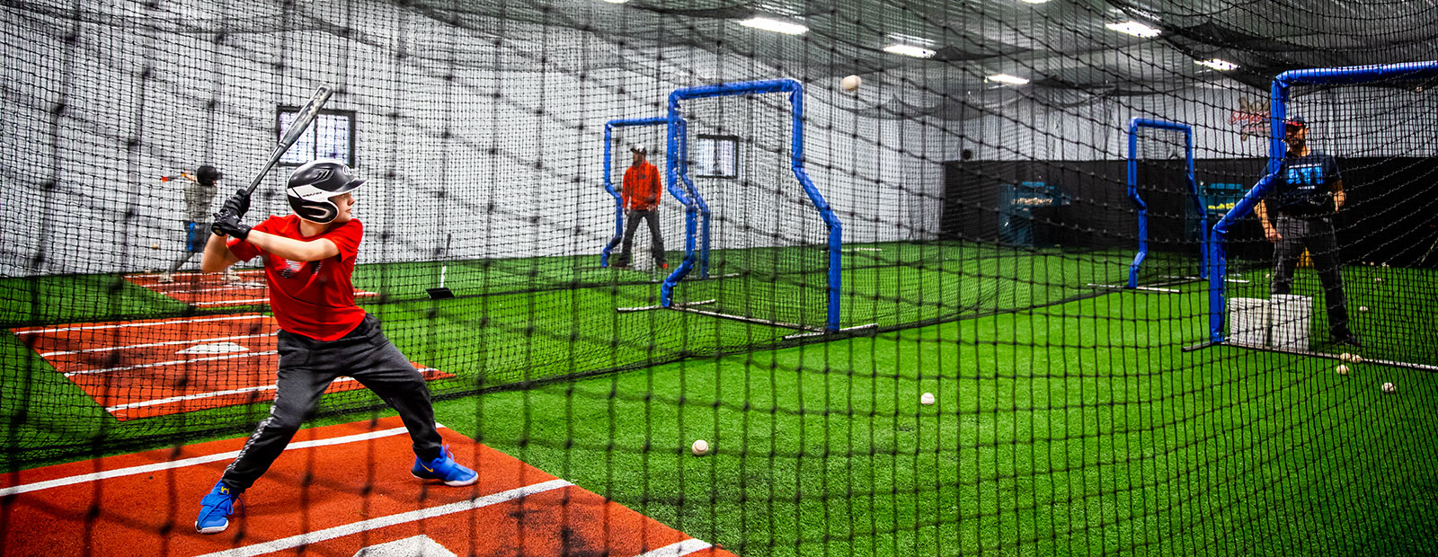 Student athletes hone their skills at Sluggers. <span class='image-credits'>David Lewinski</span>