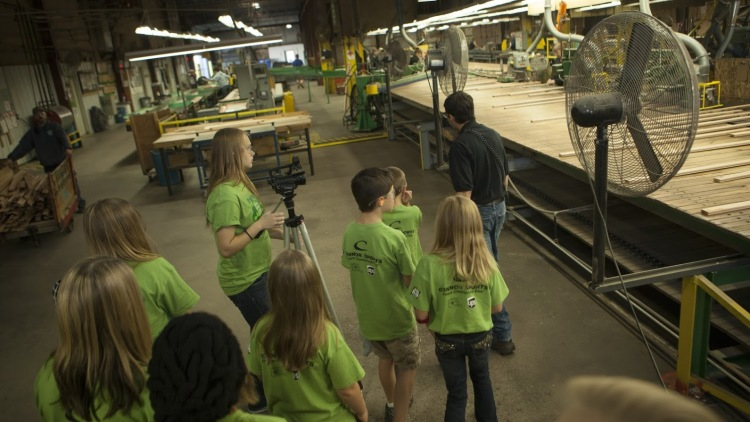 School children take a tour of Connor Sport Court's mill in Amasa, located in Michigan's Upper  Peninsula. It is here that some of the world's best basketball courts are born. (photo courtesy   Nick Jensen/Floline Media)