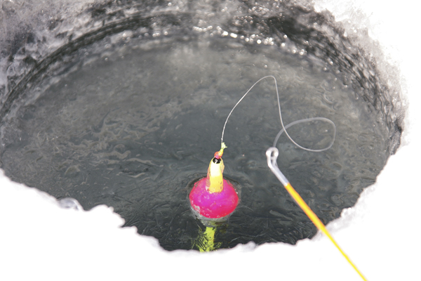 ice fishing at one of the many inland lakes in the Hiawatha National Forest