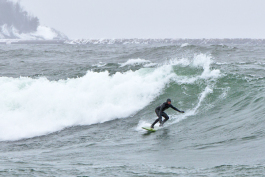Dan Schetter taking advantage of some big surf in April, Lake Superior Marquette