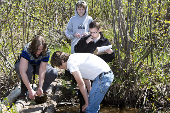 Hancock Middle School Students work on a wetlands preservation project.