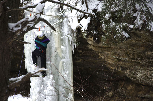 A participant in the IceFest women's ice-climbing clinic takes on Twin Falls near Munising.