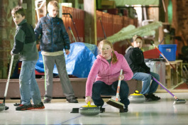 Youth learning to curl in Calumet Township in the Drill Shop.