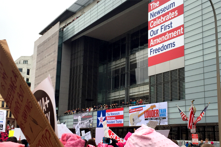 The march passes the Newseum in D.C.