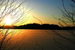The sun rises over Deer Lake in Marquette County.
