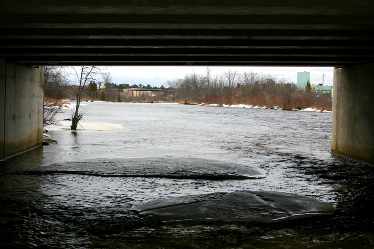 A view under one of the Manistique River bridges.